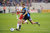 Ryan Johnson (19) of the San Jose Earthquakes is marked by Chris Albright (3) of the New York Red Bulls. The San Jose Earthquakes defeated the New York Red Bulls 3-1, (3-2) on aggregate during the 2nd leg of the Major League Soccer (MLS) Eastern Conference Semifinals at Red Bull Arena in Harrison, NJ, on November 04, 2010.