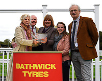 Connections of Caiya receive their trophy after winning The Byerley Stud EBF Fillies' Novice Stakes    during Bathwick Tyres Reduced Admission Race Day at Salisbury Racecourse on 9th October 2017