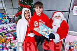 Young Oisin Noonan from Newcastlewest donating a toy for the Mas's appeal outside Smyths Toys in Manor West Shopping Centre of toys for the University Hospital children's ward and the Adapt Women's refuge to Fiona Dunne and Santa Claus,