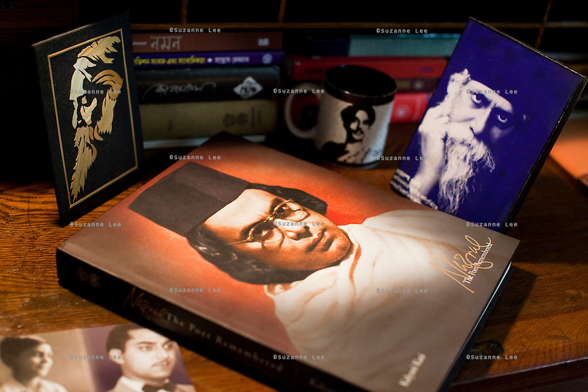 Anindita Kazi's mother, Kalyani Kazi's book on her grandfather Nazrul Islam is photographed on Anindita's reading desk that is decorated with Rabindranath Tagore and Nazrul Islam's images, in her house in Calcutta, West Bengal, India, on 17th January, 2012. The West Bengal government's attempts to rename one of its historic buildings after a Bengali poet has met with controversy. Kazi Nazrul Islam, Bangladesh's national poet's legacy has always been debated, including his relationship with other Indian intellectuals such as Rabindranath Tagore, who won the Nobel Prize for Literature in 1913. In an attempt to quell doubts, Anindita Kazi, Mr Islam's grand daughter will release a CD in which she reads from unpublished letters between the two poets to show their regard for each other. Photo by Suzanne Lee for The National (online byline: Photo by Szu for The National)