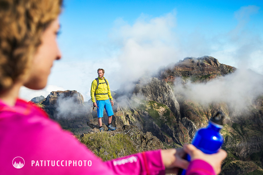 Two hikers sitting with on a day trip at Pico do Arieiro, Madeira Island's highest peak