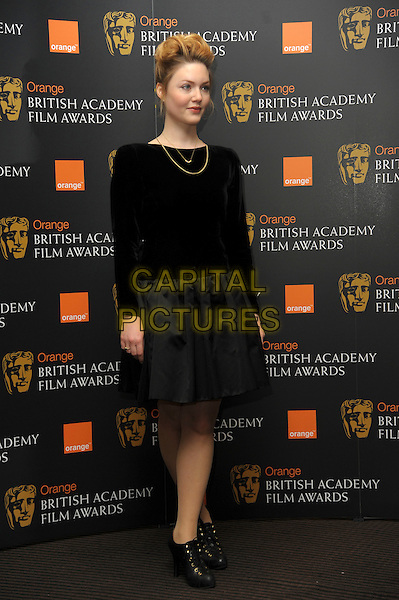 Holliday Grainger.Orange British Academy Film Awards Nominations announcement, London, England..January 17th, 2012.BAFTA BAFTAs full length black grey gray top skirt .CAP/CAS.©Bob Cass/Capital Pictures.