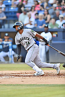Augusta GreenJackets center fielder Heliot Ramos (14) swings at a pitch during a game against the Asheville Tourists at McCormick Field on June 15, 2018 in Asheville, North Carolina. The Tourists defeated the GreenJackets 6-5. (Tony Farlow/Four Seam Images)