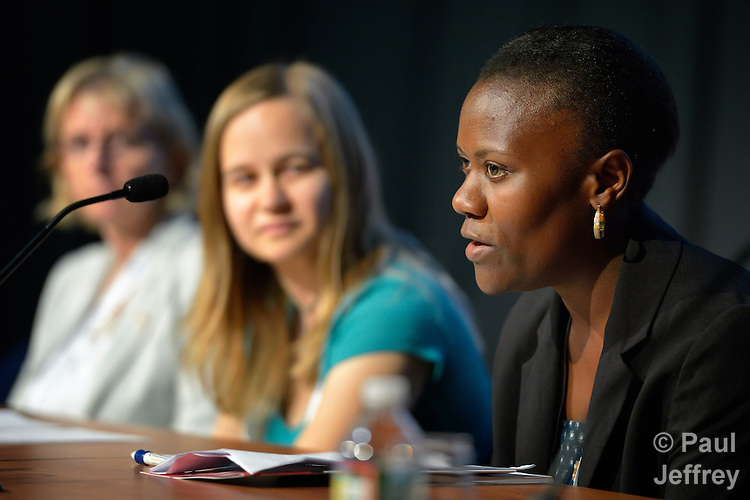 Pacem Mnyenyembe (right), an HIV positive activist with the Community of Sant'Egidio's DREAM Project in Malawi, speaks at a July 25, 2012, press conference in Washington, DC, announcing the results of a study of Catholic participation in a global plan towards the elimination of new HIV infections in children by 2015. On her right is Becky Johnson, a researcher who conducted the study for the Catholic HIV and AIDS Network (CHAN). The press conference took place during the XIX International AIDS Conference. (Photo Paul Jeffrey/EAA)
