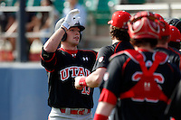 T.J. Bennett #13 of the Utah Utes is greeted by teammates after hitting a home run against the Loyola Marymount Lions at Page Stadium on February 15, 2013 in Los Angeles, California. Utah defeated Loyola 6-3. (Larry Goren/Four Seam Images)