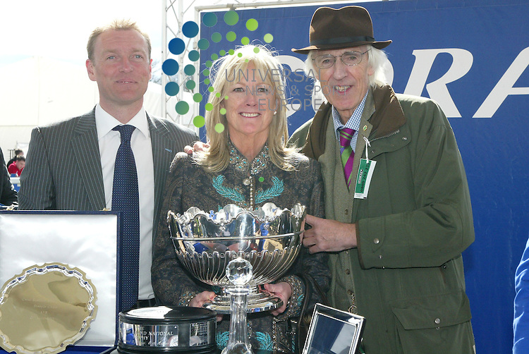 The winning horse no 13 Merigo owner Mr & Mrs Raymond Anderson Green lifting the trophy at  the Scottish Grand National races at Ayr on Saturday 21 April 2012. Universal News & Sport (Scotland)