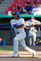 Addison Russell #27 of the Stockton Ports bats against the High Desert Mavericks at Stater Bros. Stadium on April 27, 2013 in Adelanto, California. Stockton defeated High Desert, 17-7. (Larry Goren/Four Seam Images)