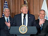 United States President Donald J. Trump makes remarks prior to signing an Energy Independence Executive Order at the Environmental Protection Agency (EPA) Headquarters in Washington, DC on Thursday, March 28, 2017.  The order reverses the Obama-era climate change policies.  US Vice President Mike Pence look on from left and EPA Administrator Scott Pruitt looks on from right.<br /> Credit: Ron Sachs / Pool via CNP