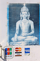ULAN BATOR, MONGOLIA..08/21/2001.Ancient winter palace of the Bogds, the spiritual and political leaders of the late Mongol empire up to the socialist revolution in 1921..Entrance of the souvenir shop, Buddha and credit cards..(Photo by Heimo Aga)