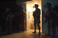 US soldiers from C Company, 1st battalion, 506th, 101st airborne division prepare to extract from an iraqi house that they used as observation post and sniper position  while conducting a night raid with the purpose of arresting two suspected major figures of the Sunni insurgency in their sector in Eastern Ramadi, Al Anbar province, Iraq on WED Jan 11 2006. the mission was divided into two sections. SECTION ONE  with the prurpose of blocking the suspected insurgents from escaping and providing sniper fire for the area and SECTION 2 raiding the house were the two were suppose to be hiding. the two suspected insurgents were nt to9o be found.