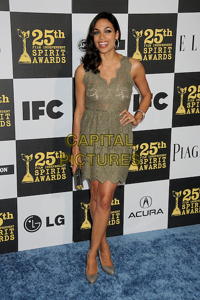 ROSARIO DAWSON.25th Annual Film Independent Spirit Awards - Arrivals held at the Nokia Event Deck at L.A. Live, Los Angeles, California, USA..March 5th, 2010.full length green dress lace sleeveless hand on hip clutch bag grey gray shoes .CAP/ADM/BP.©Byron Purvis/AdMedia/Capital Pictures.