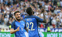 Olivier Giroud (Arsenal) of France congratulates Samuel Umtiti (Barcelona) of France on his goal to equalise at 1 1  during the International Friendly match between France and England at Stade de France, Paris, France on 13 June 2017. Photo by David Horn/PRiME Media Images.