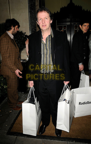 KEVIN WHATELY .At the Radio Times Covers Party, Claridges Hotel, London, England, 20th January 2009..full length black suit bags green striped shirt.CAP/CAN.©Can Nguyen/Capital Pictures