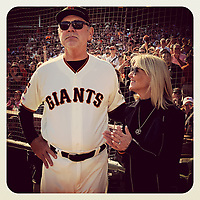 SAN FRANCISCO, CA - SEPTEMBER 29: iPhone Instagram manager Bruce Bochy of the Giants and his wife Kim stand on the field during ceremonies honoring his career after his last game ever as Giants manager after the game between the Philadelphia Phillies and San Francisco Giants at Oracle Park on September 29, 2019 in San Francisco, California. (Photo by Brad Mangin)