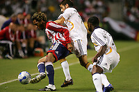 CD Chivas USA defender Lawson Vaughn (25) defends a ball against LA Galaxy midfielder Kyle Martino (18) as Galaxy defender Mike Randolph (2) looks on. CD Chivas USA defeated the LA Galaxy in the Super Clasico 3-0 at the Home Depot Center in Carson, CA, Thursday, September 13, 2007.