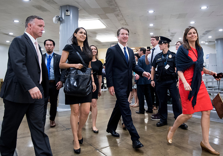 UNITED STATES - JULY 11: Supreme Court nominee Brett Kavanaugh walks through the Senate subway tunnel on his way to meet with Sen. Lindsey Graham, R-S.C., in the Russell Senate Office Building on his second day of meetings with senators in the Capitol on Wednesday, July 11, 2018. (Photo By Bill Clark/CQ Roll Call)
