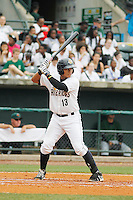 Charleston RiverDogs catcher Alvero Noriega (13) at bat during a game against the Augusta GreenJackets at Joseph P.Riley Jr. Ballpark on April 15, 2015 in Charleston, South Carolina. Charleston defeated Augusta 8-0. (Robert Gurganus/Four Seam Images)