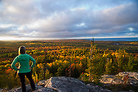 Trail running with evening light and fall color atop Hogback Mountain near Marquette, Michigan on Michigan's Upper Peninsula.