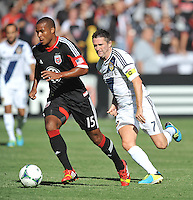 Ethan White (15) of D.C. United goes against Robbie Keane (7) of the Los Angeles Galaxy.  D.C. United tied the Los Angeles Galaxy 2-2, at RFK Stadium, Saturday September 14 , 2013.