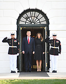 United States President Donald J. Trump and first lady Melania Trump walk out of the White House to lead a moment of silence in remembrance of those lost on September 11, 2001 on the South Lawn of the White House in Washington, DC on Monday, September 11, 2017.<br /> Credit: Ron Sachs / CNP