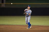 AZL Royals second baseman Kember Nacero (2) makes a throw to first base during an Arizona League game against the AZL Giants Black at Scottsdale Stadium on August 7, 2018 in Scottsdale, Arizona. The AZL Giants Black defeated the AZL Royals by a score of 2-1. (Zachary Lucy/Four Seam Images)