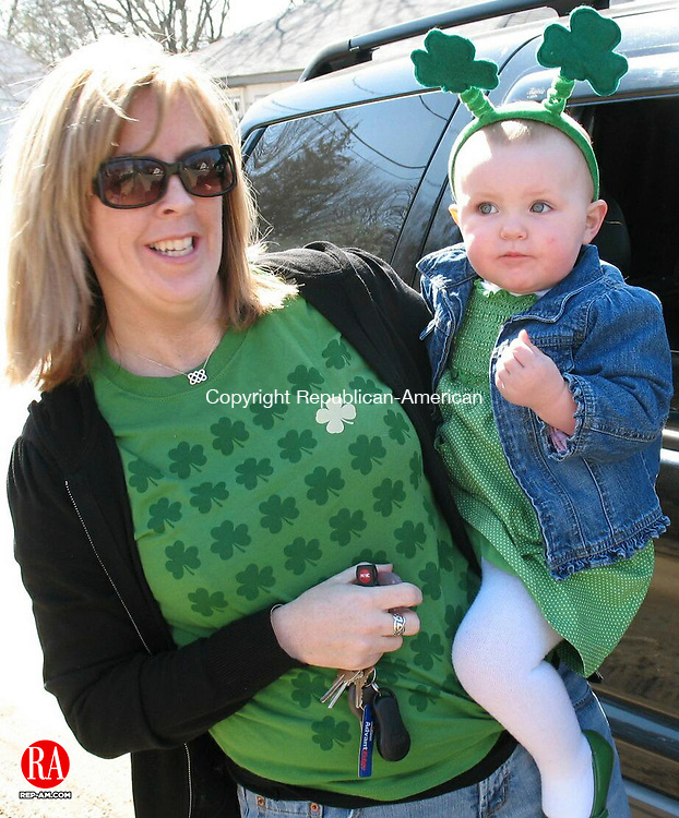 WATERBURY, CT 08 March 2009 - 030709RA02 - Bridget Collins-Regan and her 18-month-old daughter, Katherine, at the St. Patrick's Day parade hosted by the Monsignor Slocum Division #1 Ancient Order of Hibernians on Saturday in Waterbury.