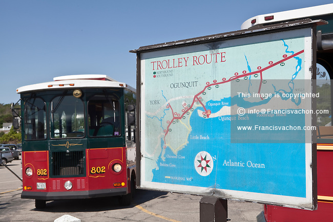 An Ogunquit trolley is parked by a trolley route map in Ogunquit, Maine Saturday June 15, 2013. The Ogunquit Trolley is part of the Shoreline Explorer that links Kennebunk to York.