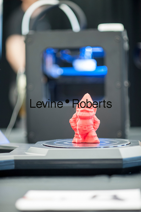 A MakerBot Industries MakerBot Digitizer Desktop 3D scanner scans a gnome figure in the MakerBot offices in New York on Friday, September 20, 2013. MakerBot introduced their $1400 MakerBot Digitizer Desktop 3D scanner which will enable users to scan objects up to 8X8X8 inches and print out duplicates on their $2199 Replicator 2 or another brand of 3D printer. The devices, which are revolutionizing small industries, enables the user to produce small plastic objects manufactured via extrusion on their desktop via the automated machines. (© Richard B. Levine)