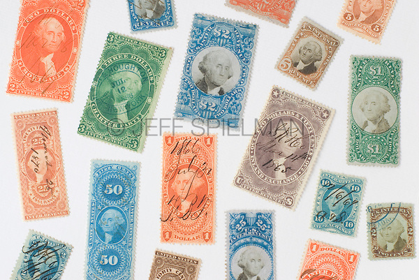 AVAILABLE FOR COMMERCIAL OR EDITORIAL LICENSING FROM GETTY IMAGES.  Please go to www.gettyimages.com and search for image # 173083833.<br /> <br /> Antique United States Revenue Stamps (Tax Stamps) issued by the U.S. government between the years 1862 and 1872.  These stamps, featuring a portrait of President George Washington, were used on documents and other paper items during the Civil War and in the following decade to show proof of payment of federal taxes.