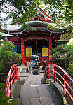 Visitors pray at Benzaiten shrine inside the grounds of Inokashira Park in the trendy neighborhood of Kichijoji in Musashino City,  Tokyo, Japan on 16 Sept. 2012.  Photographer: Robert Gilhooly