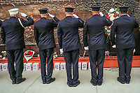 NEW YORK, NY - SEPTEMBER 11, 2016: Firefighters pay their respects at the at the (FDNY) Memorial Wall Located at FDNY Engine and Ladder 1during the 15th anniversary of the 9/11 attacks on September 11, 2016 in New York. Photo by (VIEWpress/Maite H. Mateo)