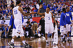 Guard Tyler Ulis of the Kentucky Wildcats high fives Willie Cauley-Stein during the game against the Wisconsin Badgers in the Final Four of the 2015 NCAA Men's Basketball Tournament at Lucas Oil Stadium on Saturday, April 4, 2015 in Indianapolis, In.  Photo by Michael Reaves | Staff.