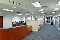 The front desk reception  area of the VNA health center in Aurora, IL designed by Kluber, Skahan and Associates.