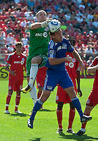 05 June 2010: Toronto FC goalkeeper Stefan Frei #24 battles with Kansas City Wizards defender Jimmy Conrad #12 during a game between the Kansas City Wizards and Toronto FC at BMO Field in Toronto..The game ended in a 0-0 draw.