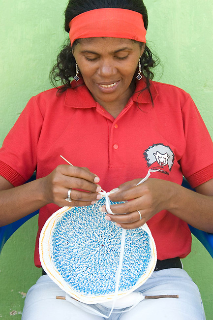Colombian asoartesana knitting mochilas and other products woven from recycled plastic bags. This project has recycled more than 1.5 million plastic bags and provides an income to the village living around the forest, thereby protecting the Cotton-top tamarin. Los Limites, Colombia.