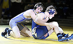 SIOUX FALLS, SD: DECEMBER 8: Cody Pack from South Dakota State battles with Brayden Neises from Augustana in their 157 pound match Sunday afternoon at the Sanford Pentagon. (photo by Dave Eggen/Inertia)