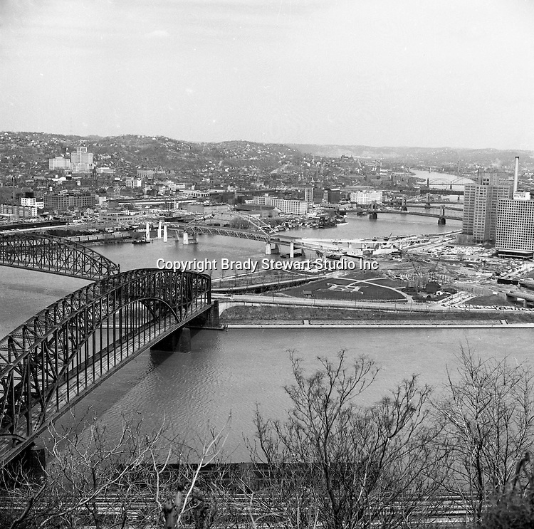 Pittsburgh PA:  View of the Point Bridges and the Fort Duquesne bridge construction - 1962.  Pittsburgh's Point bridge in foreground and Point State Park under construction.