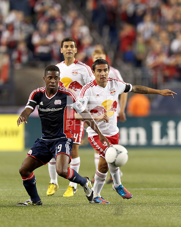 New England Revolution midfielder Clyde Simms (19) and New York Red Bulls forward Tim Cahill (17) battle for the ball. Despite a red-card man advantage, in a Major League Soccer (MLS) match, the New England Revolution tied New York Red Bulls, 1-1, at Gillette Stadium on September 22, 2012.