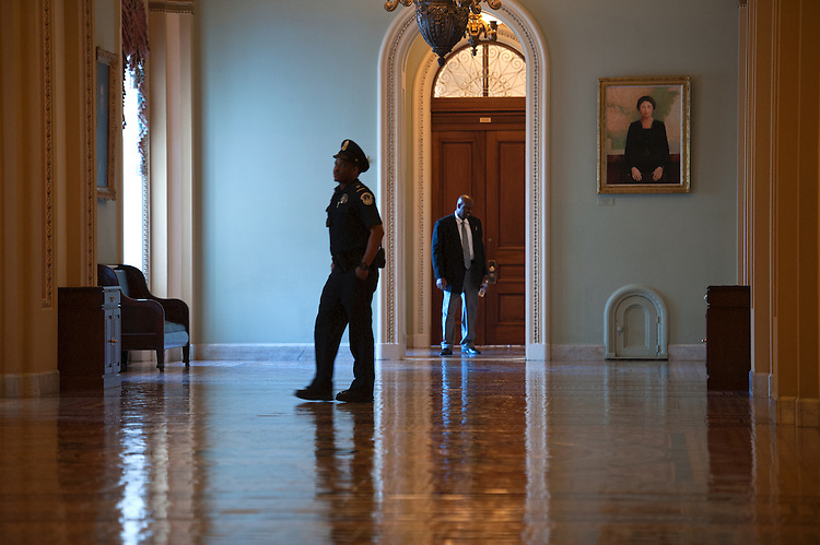 UNITED STATES - Nov 18: U.S. Capitol Hill Police stand guard in a empty Ohio Clock Corridor of the U.S. Capitol as members make their way back to Washington to start their work week on November 18, 2013.   (Photo By Douglas Graham/CQ Roll Call)