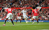 Pictured: Gylfi Sigurdsson of Swansea (C) scoring his goal, making the score 2-1 to his team. Saturday 16 August 2014<br />
