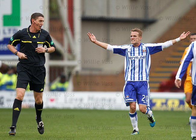 Dean Shiels remonstrates with referee Craig Thomson