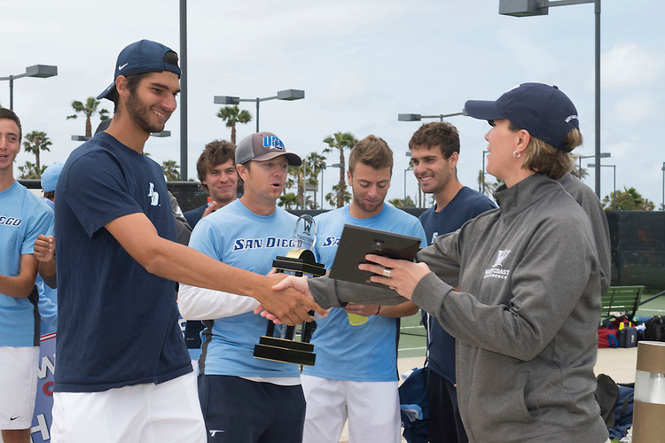 April 26, 2014; San Diego, CA, USA; San Diego Toreros player Alexandros Araouzos (left) and WCC executive senior associate commissioner/COO Lynn Holzman (right) during the finals of the WCC Tennis Championships at Barnes Tennis Center.