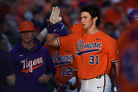 Center fielder Bryce Teodosio (31) of the Clemson Tigers is congratulated after scoring his first collegiate run in a game against the William and Mary Tribe on February 16, 2018, at Doug Kingsmore Stadium in Clemson, South Carolina. Clemson won, 5-4 in 10 innings. (Tom Priddy/Four Seam Images)
