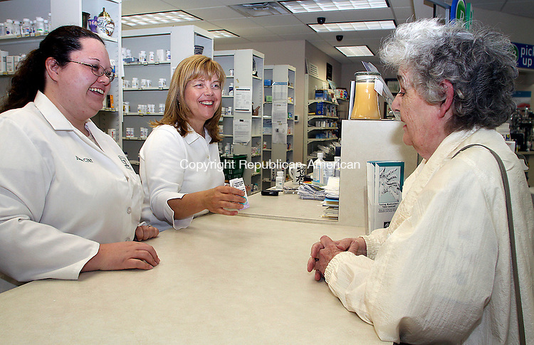 BEACON FALLS JUNE CT.-17  JUNE 2010-061710DA02- Maryellen Cameron, right, of Beacon Falls drops off her prescription to  pharmacist and co owner of  Beacon Falls Pharmacy Marion Bradley, center, and certified pharmacy technician Rose Sullivan on Thursday. <br /> Republican American  Darlene Douty