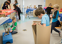 NWA Democrat-Gazette/CHARLIE KAIJO Jaxson Munson, 6, of Cave Springs explores materials for a superhero costume as campers create their own Comic-Con displays during a weeklong camp about superheroes, Thursday, March 21, 2019 at the Amazeum in Bentonville. <br /> <br /> Campers honed their superhero knowledge to create their own action figures and Comi-Con displays in a weeklong superhero camp that concludes Friday. They started the camp with a visit to Crystal Bridges to see the new exhibit, &ldquo;Men of Steel, Women of Wonder&rdquo; before making their own