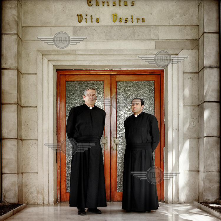 Father William Brock (left), born in North Carolina in the USA, and Father Leopoldo Cuchillo (right), born in Madrid, outside the Legionaries of Christ seminary in Salamanca. Both are assistants of seminary training. The Legion of Christ is a conservative Roman Catholic congregation whose members take vows of chastity, obedience and poverty. Father William became a member in 1967, and Father Leopoldo in 1985.