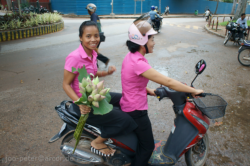 women with lotus on scooter, Siem Reap, Cambodia, August 2011
