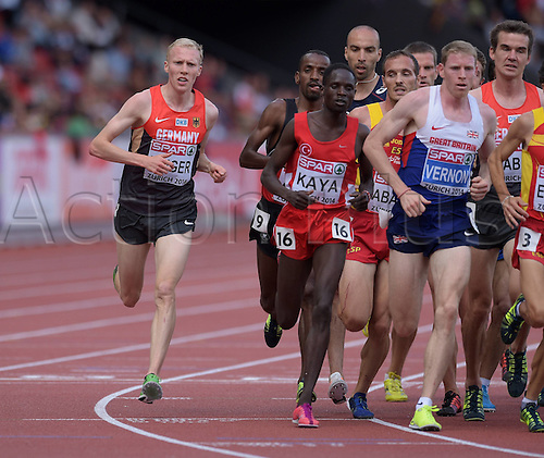 17.08.2014. Zurich, Switzerland. European Athletics Championships 2014 at the Letzigrund stadium in Zurich, Switzerland. Richard Ringer ger Ali KayarkTuk Andy Vernon GBR in the 5000 Metres Final for men