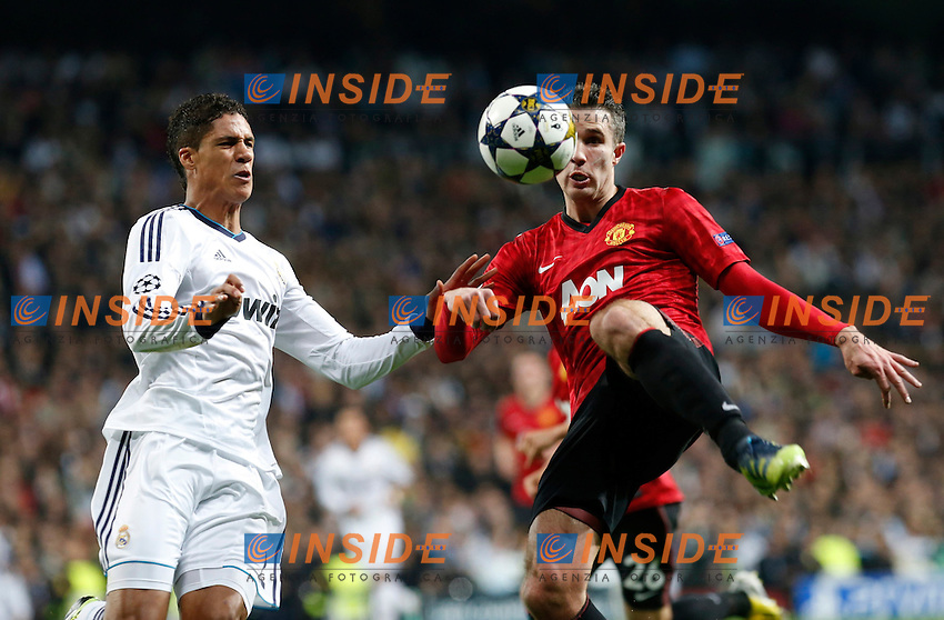 Real Madrid's Raphael Varane (l) and Manchester United's Robin Van Persie during Champions League 2012/2013 match.February 12,2013. (ALTERPHOTOS/Alfaqui/Alex Cid-Fuentes) .Madrid 13/2/2013 Santiago Bernabeu.Football Calcio 2012/2013 Champions League.Real Madrid Vs Manchester United.Foto Alterphotos / Insidefoto .ITALY ONLY