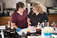 Summer research student Peyton Williams works with Dr. Katie Cooley-Locke.